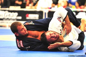 Roberto Cyborg Abreu applying a lapel choke at the 2009 Pan Ams